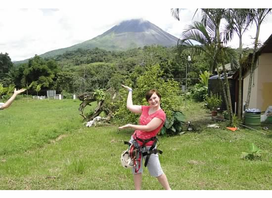 posing with the volcano after jungle Zip Lining in Costa Rica